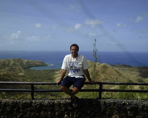 Chris at a scenic overlook in southern Guam, where dolphins frequent the bays