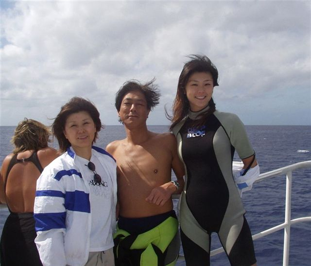 A family of divers heading out to sea