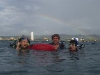 Two new OW divers coming up in time to see a rainbow over the harbor on May 4, 2004